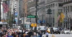West 42 Crossing Fifth Avenue Crowd People Passing Sidewalk Car Traffic Busy NYC Stock Footage
