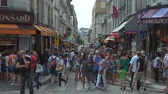 Busy commercial road Paris souvenir shop tourist people attraction traditional  Stock Footage