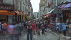 Timelapse crowded commercial street Paris downtown busy vintage souvenir shop Stock Footage