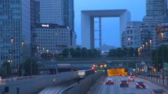 Timelapse Grand Arch traffic street busy freeway metro train pass twilight Paris Stock Footage