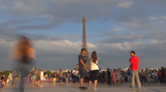 Timelapse happy tourist people enjoy Eiffel Tower sunset take photo Paris city Stock Footage