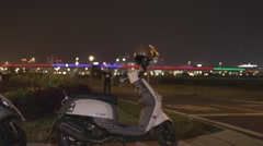 Parked scooter at the Taipei riverside - cinematic Stock Footage