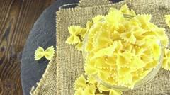 Uncooked farfalle pasta (seamless loopable) Stock Footage