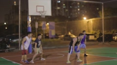 Asian men play basketball - layup the rebound Stock Footage