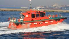 Tug board speeding up into open sea Stock Footage