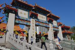 hong kong people visit the wong tai sin buddhist temple - stock photo