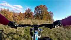 Hd: downhill cycling - stock video. mountain biker, cycling downhill in the f Stock Footage