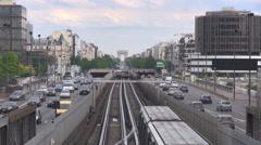 Public transportation Paris downtown metro pass railway traffic car freeway day Stock Footage