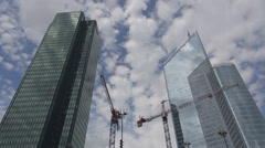 Financial center development crane machine work La Defense Paris business build Stock Footage
