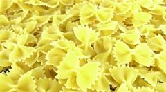 uncooked farfalle pasta (seamless loopable) - stock footage