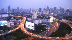 Speed video high view of night bangkok traffic and building Stock Footage