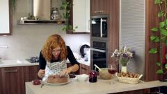 Woman decorating homemade cake Stock Footage