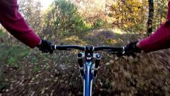 Downhill bike cycling. riding a bicycle through autumn forest Stock Footage