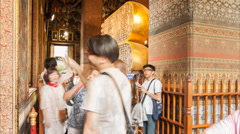 Timelapse of tourist walking and looking thai tradinal art in church of wat p Stock Footage