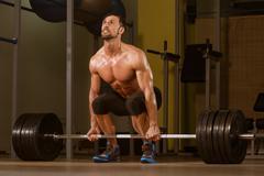 Bodybuilder doing deadlift for back Stock Photos