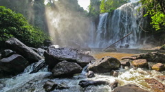 Tropical waterfall with sun rays Stock Footage