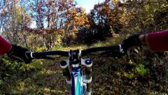 Hd, experienced mountain biker speeding down the mountain trail  Stock Footage