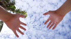 Hands Reach for the Sun and Blue Cirris Sky. Stock Footage