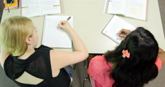 Students doing their assignments/homework in class. Ultra HD 4K Stock Footage