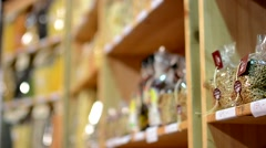 Colourful pasta in bags in shelf - shop Stock Footage