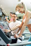Personal trainer instructing woman Stock Photos