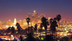 Downtown Los Angeles view palm trees in foreground. 4K UHD timelapse hyperlapse. Stock Footage