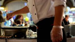 Chef prepares a pancake - people in background Stock Footage