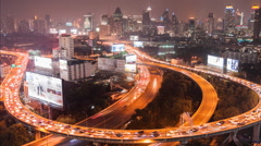 Timelapse high view of night bangkok traffic and building Stock Footage