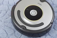 Irobot roomba vacuum cleaning robot Stock Photos