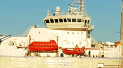 2608 Large White Ships at Dock During Sunset and Orange Emergency Boat, 4K Stock Footage
