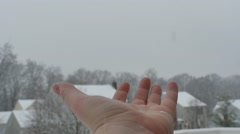 2624 Hand Reaching Out For Snowflakes During Snow Storm in Slow Motion Stock Footage