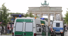 Stock Video Footage of Brandenburg Gate Berlin City March Police Guard Flank People Protest Anti Racism