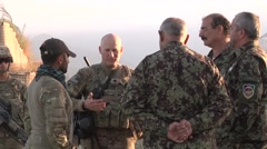 Afghan And ISAF Soldiers Stand In Camp And Talk Together - stock footage