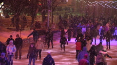 MOSCOW, RUSSIA. 04 JAN 2014: People ride on the open ice rink in Gorky Park. Stock Footage