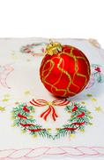 Red Christmas ball embroidered napkin isolated Stock Photos