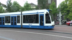 Tracking, handheld shot of a passing tram in Amsterdam, Netherlands. Stock Footage