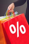 discount percentage symbol on red shopping bag - stock photo