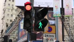 Traffic signal lights and crosswalk lights at Causeway Bay in Hong Kong Stock Footage