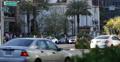 People Walking Pedestrians Crossing Las Vegas Boulevard Cars Passing Street Sign Footage