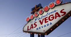 Fabulous Las Vegas Welcome Nevada Neon Sign Panoramic Shot Pan Right Dusk Lights Stock Footage