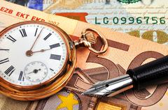 gold watch and euro bills - stock photo