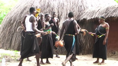 Masai tribe with national dances and songs, preparations for show - stock footage