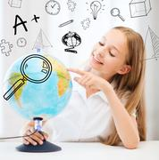 student girl with globe at school - stock photo