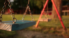 Empty swing at the playground Stock Footage