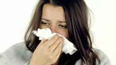 Woman feeling ill with fever coughing closeup Stock Footage