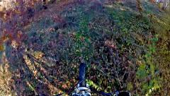 A mountain bike rushes down an off road trail with lots of trees and bushes  Stock Footage