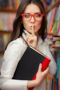Young Woman Asking for Silence in the Library Stock Photos