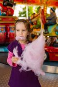 Child with cotton candy Stock Photos