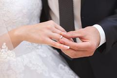Hand of the groom and the bride with wedding rings at a wedding party Stock Photos