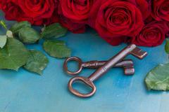 Keys with crimson roses - stock photo